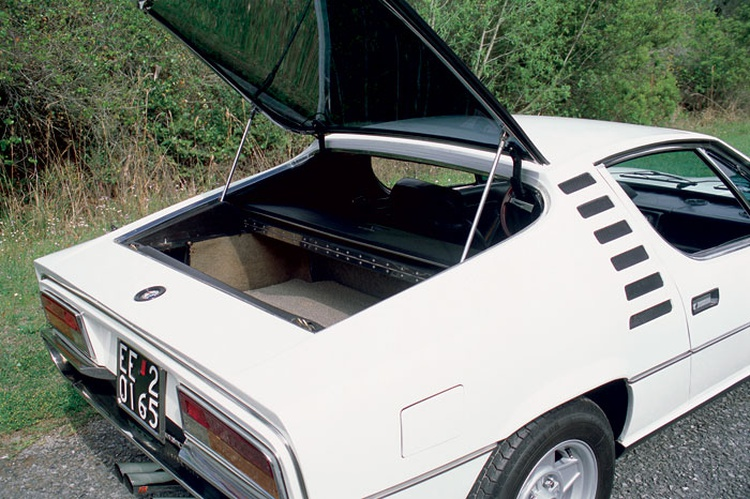 The Alfa Romeo Montreal overflows with unique styling elements, from the headlight treatment and dramatically sculpted front end to the large vents flanking the rear window hatch.