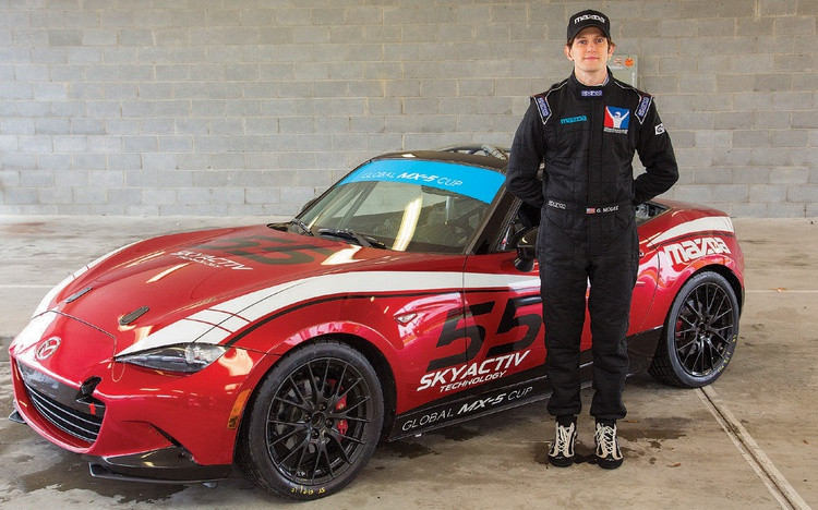 Glenn McGee poses next to his real life ride.