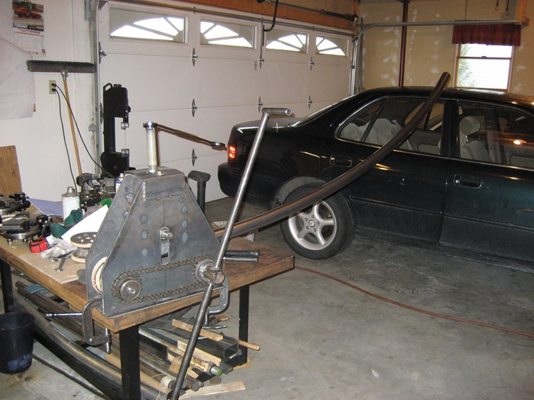 After fabricating his own tube-bending device, Jon cut, bent and welded a stack of long steel tubes to form the car's complex frame and suspension.