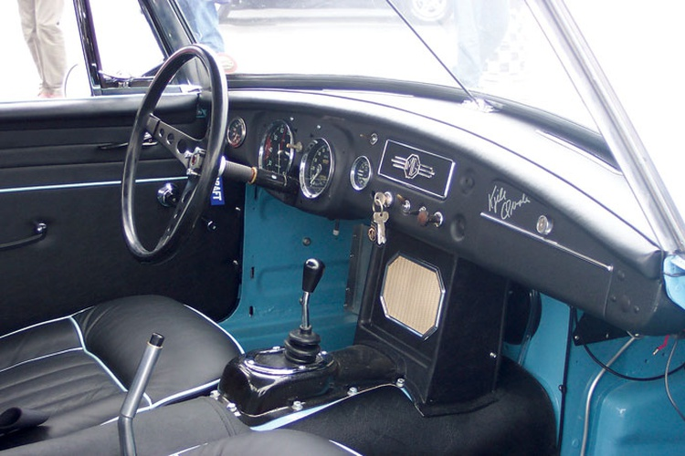 The interiors of all three team cars were very close to stock in appearance, using the original seats, complete with contrasting piping to match the body color.