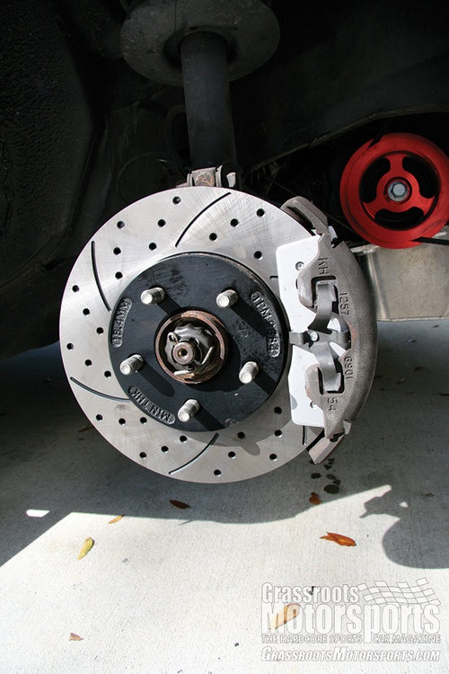 Mushy brakes gave us a great excuse to upgrade. We chose Carbotech pads that were both autocross and rallycross friendly, as well as drilled and slotted rotors from RacingBrake.