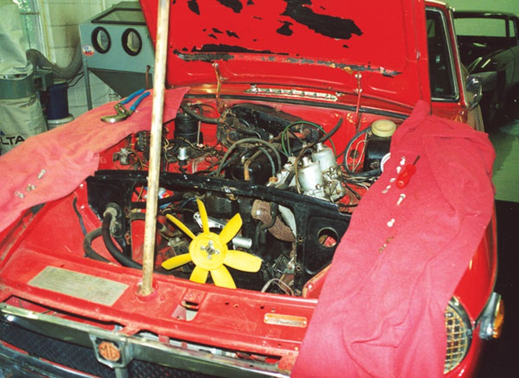 The engine compartment was partially disassembled to replace or repair the needed parts.