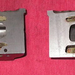 This cutaway MGB cylinder head shows the stock exhaust port (right) compared to a ported exhaust port. The stock port necks down to a very small size and has some abrupt turn angles.
