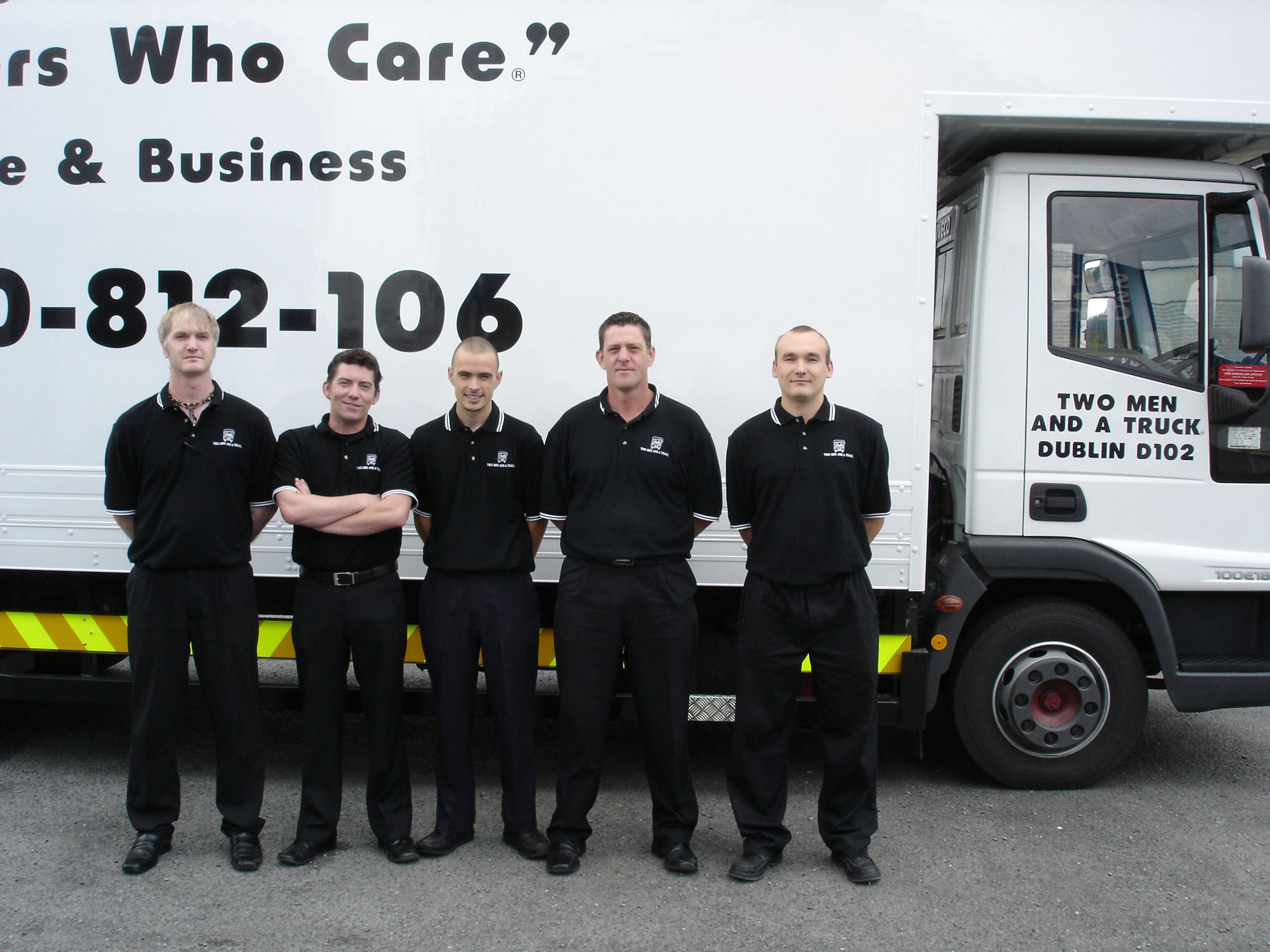 Irish TWO MEN AND A TRUCK team members stand in front of moving truck