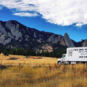 Moving truck in front of mountains