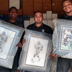 Movers Holding NFL memorabilia