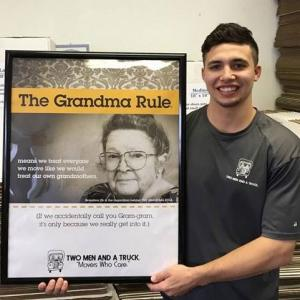 mover holding poster that shows the grandma rule