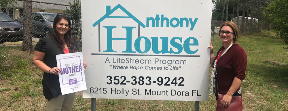 standing in front of the Anthony House in orlando fl movers for moms