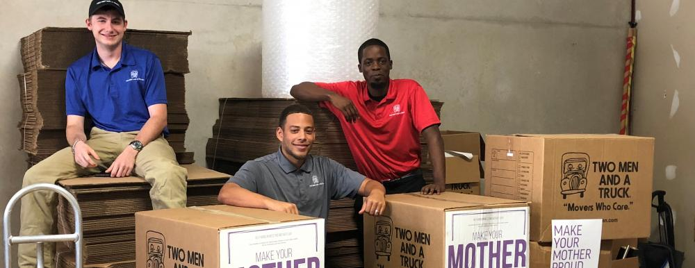 two men and a truck movers for moms team photo sugar land