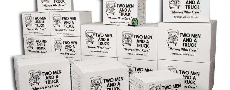 stack of two men and a truck company moving boxes