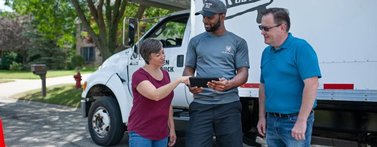 mover explaining services to a couple