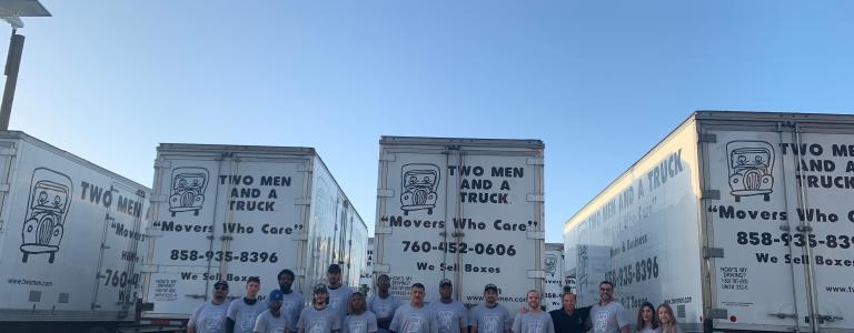 san diego moving team standing in front of two men and a truck fleet in san diego