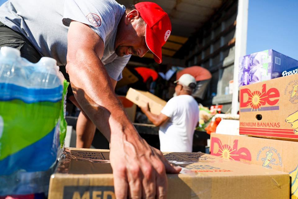 Volunteers from Convoy of Hope load a truck with supplies for The Bahamas after Hurricane Dorian