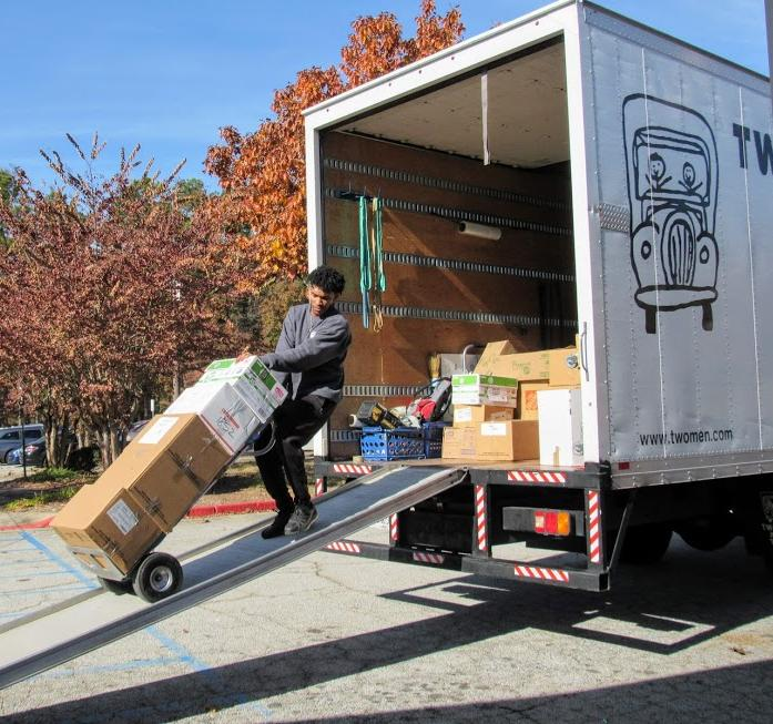 Mover, Vincent, Loading the donations from Smith Middle School.