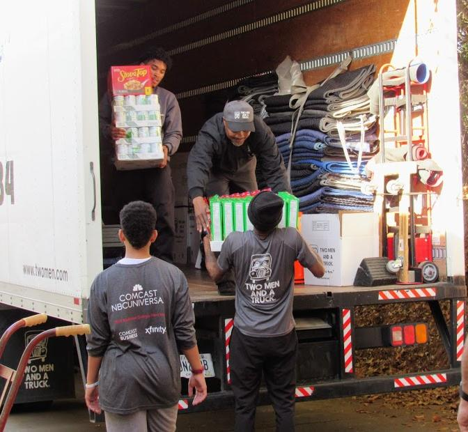 TWO MEN AND A TRUCK movers volunteering at The Center of Fanily Resources.