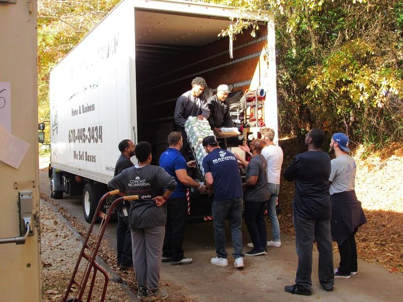 Our movers working with the community to unload at the donation center.