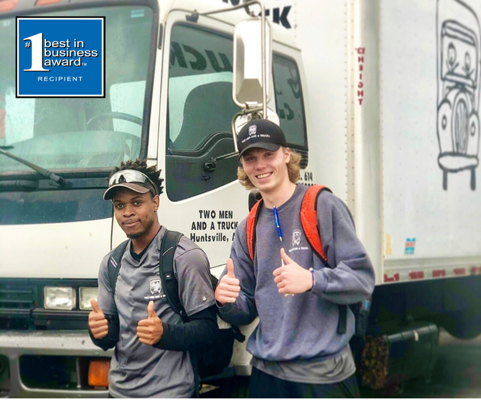 Huntsville movers, Tommy and Jacob, smile in front of a truck