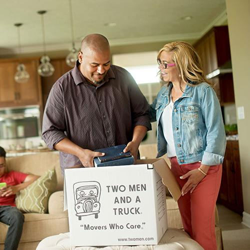 family packing items into a box