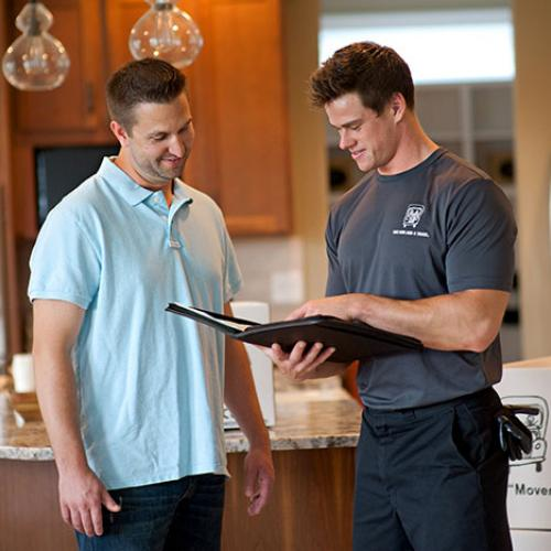 mover showing a customer a checklist