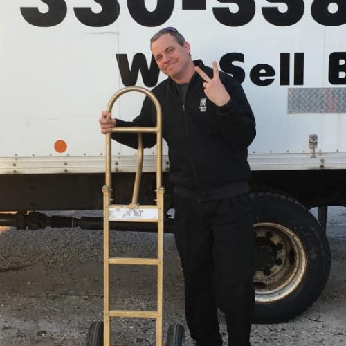 Brad Novotny with the Golden Dolly in front of Moving Truck