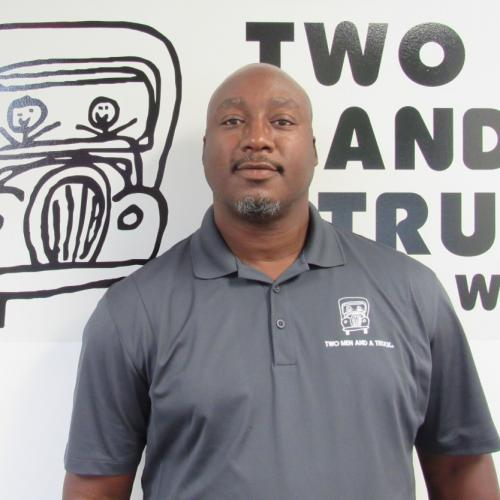 Operations Manager, Delvin Talton standing in front of out Truckie logo.