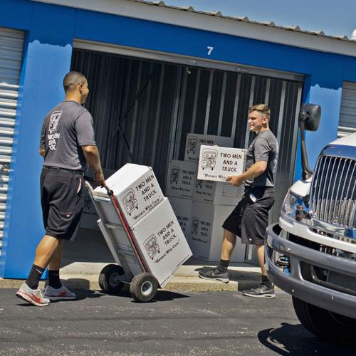 Two men and a truck movers providing storage services