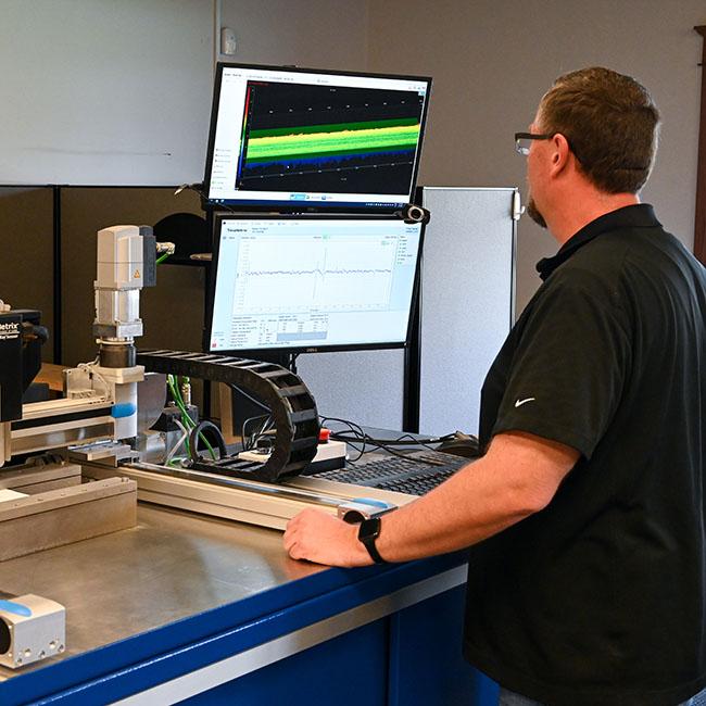 case study beta emission gauging system for manufacturer's client