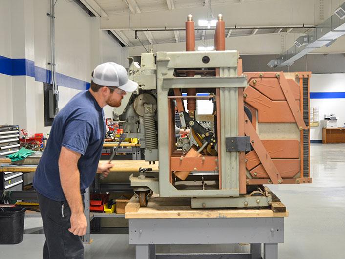 case study large metropolitan utility company trip shaft bearing replacement in GE magne-blast medium voltage circuit breaker
