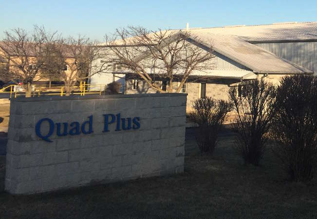our story header image of quad plus HQ