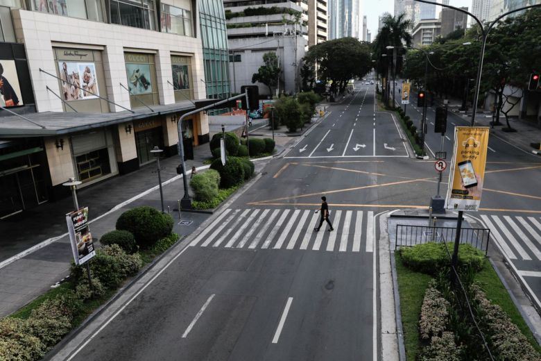 Empty streets of the business district of Makati city during the lockdown in Metro Manila. PHOTO:Reuters