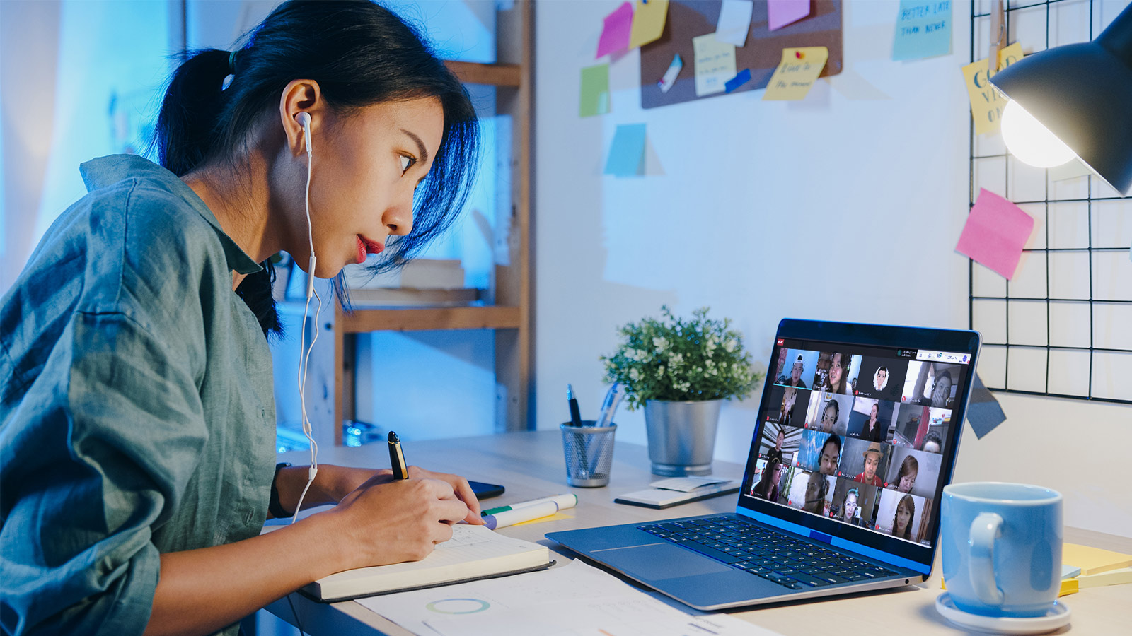 Girl writing while in a virtual meeting