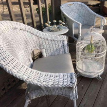 Vintage white wicker chairs and coffee table