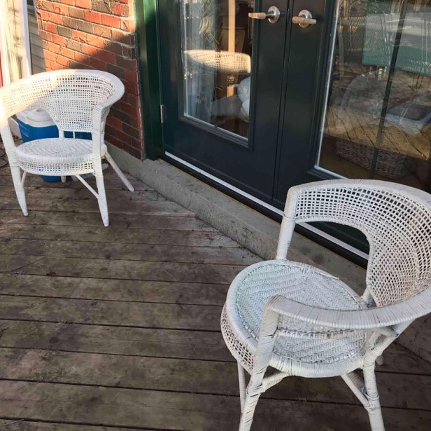 White outdoor chaise with cushions & two small tub chairs