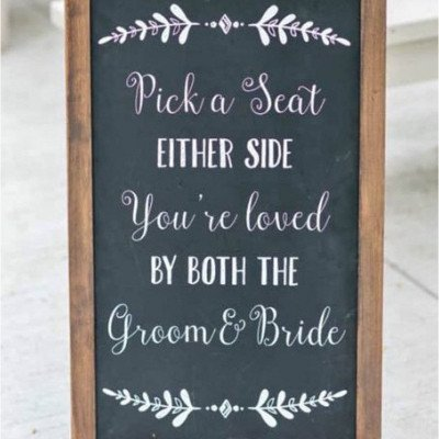 pick a seat either side sign