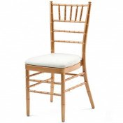 Gold chiavari chairs with white leather cushion