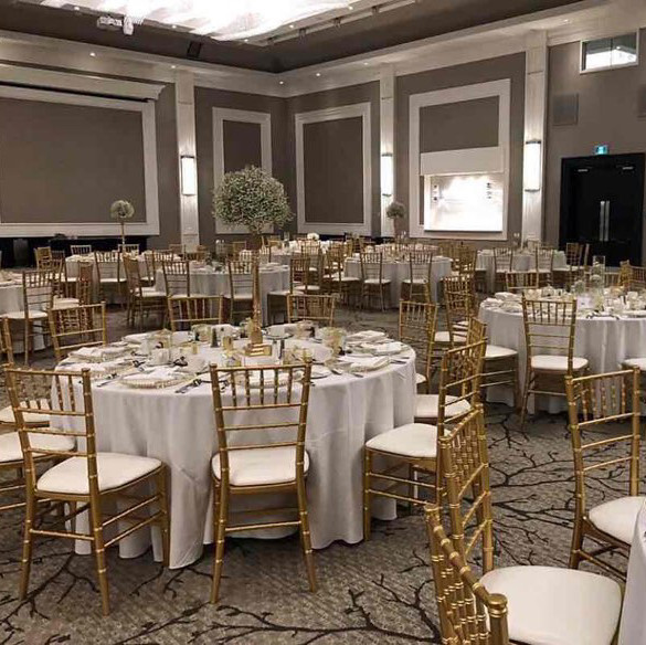 Gold chivari chairs with white leather cushion