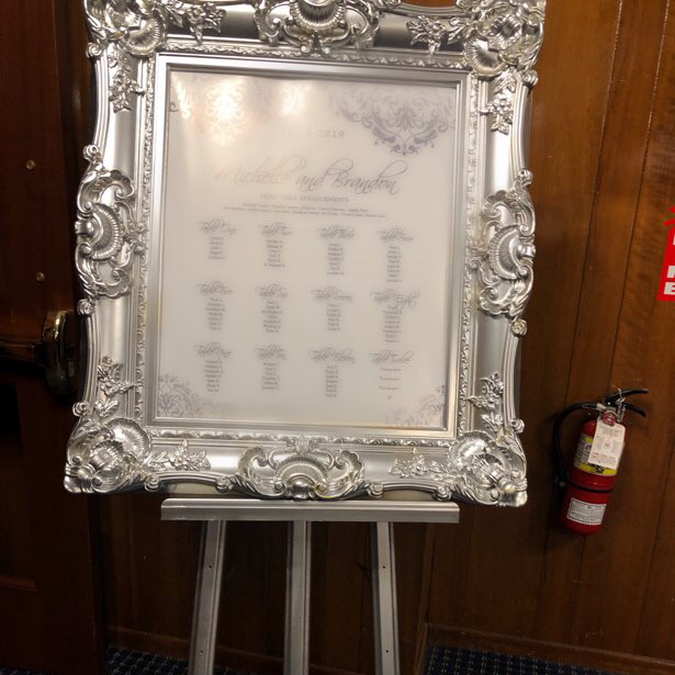 silver ornate frame with matching easel