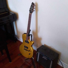 Electric guitar with practice amp