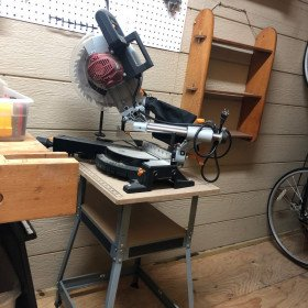 "10"" sliding compound miter saw on its own stand"