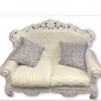 white loveseat with pillow