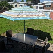 Table with umbrella and chairs