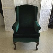 Forest green velvet armchair