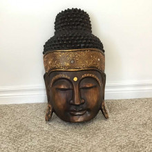 Decorative hand carved wooden Buddha head