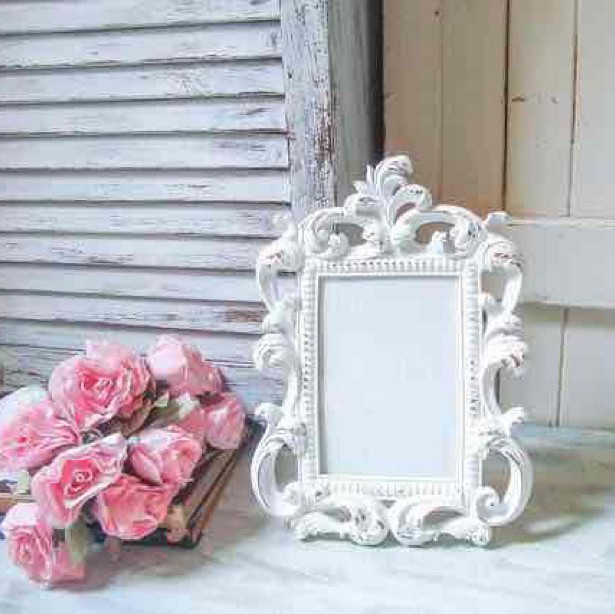 Vintage white frames for table numbers