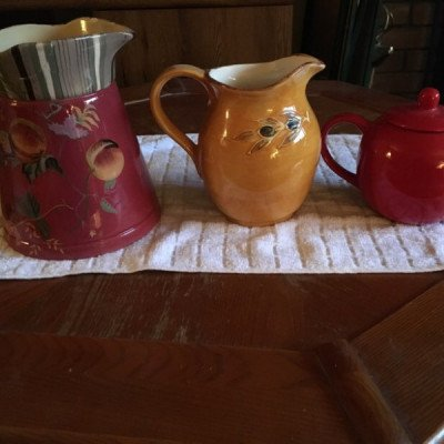 colourful  water jugs and tea pot