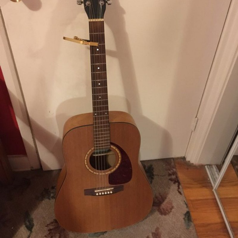 Simon and Patrick 6 string acoustic guitar