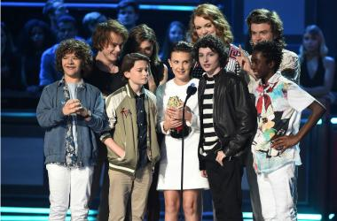 Charlie Heaton, Natalia Dyer, Gaten Matarazzo, Shannon Purser, Millie Bobby Brown, Finn Wolfhard, Joe Keery, and Caleb McLaughlin accept the award for Show of the Year on the 2017 MTV Movie & TV Awards at the Shrine Auditorium on May 7, 2017 in Los Angele