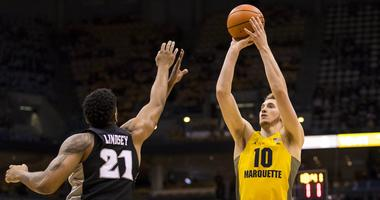 Marquette opens season with 67-42 win over UMBC