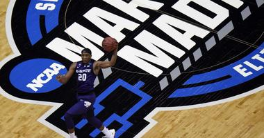 Kansas State Advances!  KSU 61 Kentucky 58