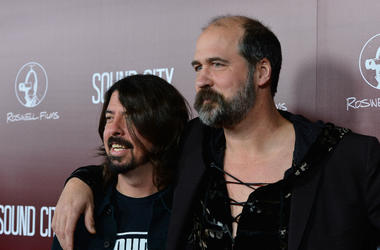 Musician Dave Grohl and Krist Novoselic arrive at the Premiere Of 'Sound City' in 2013